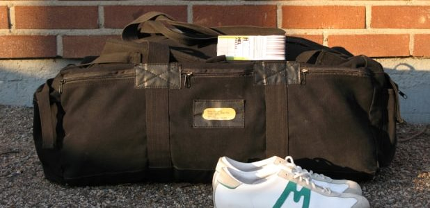 Duffel bag and a pair of shoes