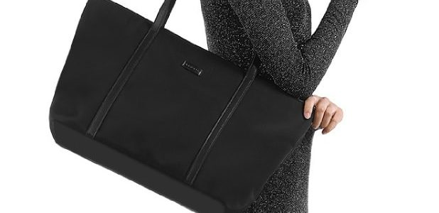 Woman carrying a black tote bag